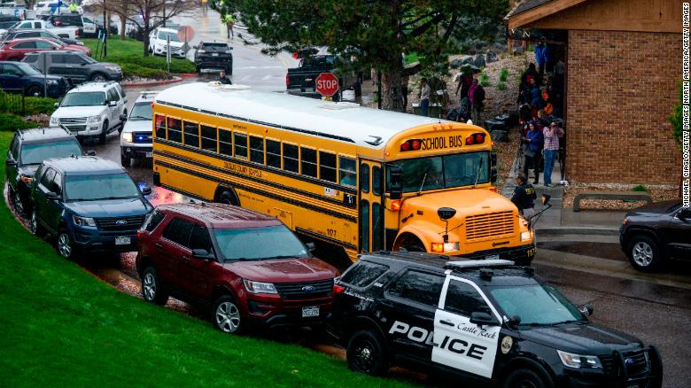 A bus evacuating students arrives at the Recreation Center at Northridge after at least seven students were injured during a shooting at STEM School Highlands Ranch on May 7, 2019 in Highlands Ranch, Colorado. (Photo by Michael Ciaglo/Getty Images)