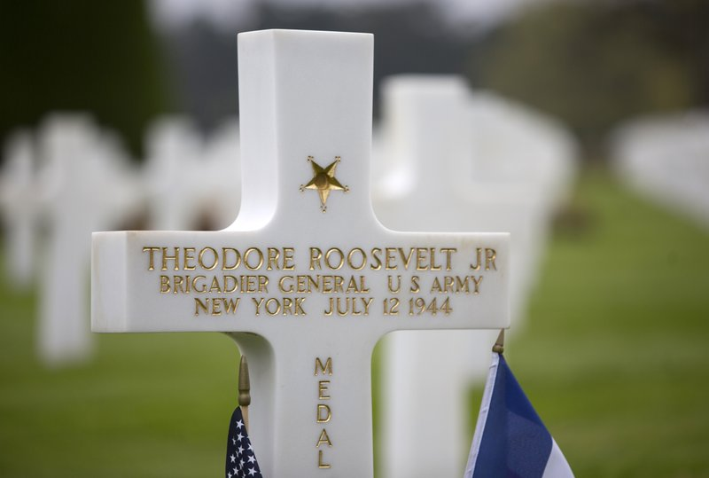 In this Wednesday, May 1, 2019 photo, the headstone of World War II U.S. Brigadier General Theodore Roosevelt Jr is photographed at the Normandy American Cemetery in Colleville-sur-Mer, France. President Trump and his French counterpart Emmanuel Macron will next week honor the dwindling number of veterans of the D-Day landing that turned World War II amid plenty of signs the bonds of friendship are under strain. The United States has had a special bond with France throughout its history and especially during two world wars over the past century when even future presidents and sons of presidents risked their lives for the freedom of a friendly nation. (AP Photo/Virginia Mayo)