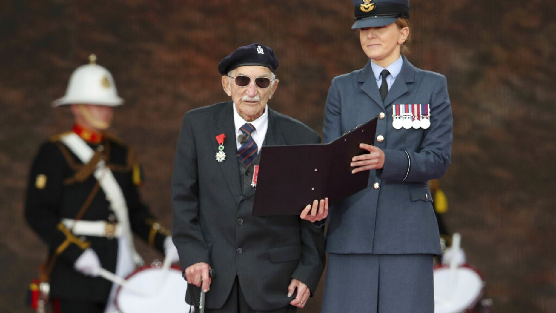 D-Day veteran John Jenkins on stage during commemorations for the 75th Anniversary of the D-Day landings, in Portsmouth, England, Wednesday June 5, 2019. (PA via AP)
