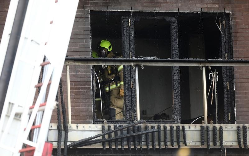 Firefighters work at the building where a fire broke out in Barking, London, Britain, June 9, 2019. (REUTERS/Simon Dawson)