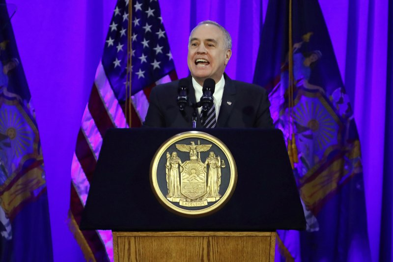 FILE - In this Jan. 1, 2019 file photo, New York State Comptroller Thomas DiNapoli delivers his address after taking his oath of office, on Ellis Island in New York harbor. New York's publicly funded Medicaid program paid more than $63,000 for erectile dysfunction drugs and other sexual treatments for sex offenders, despite laws banning such expenses. The figures come from an audit released Wednesday, June 5 by DiNapoli and first reported by The Associated Press. (AP Photo/Richard Drew, File)