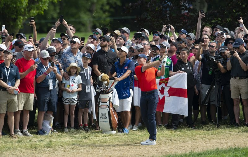 Rory McIlroy of Northern Ireland hits an approach shot on the ninth hole during the final round of the Canadian Open golf championship in Ancaster, Ontario, on Sunday, June 9, 2019. (Adrian Wyld/The Canadian Press via AP)