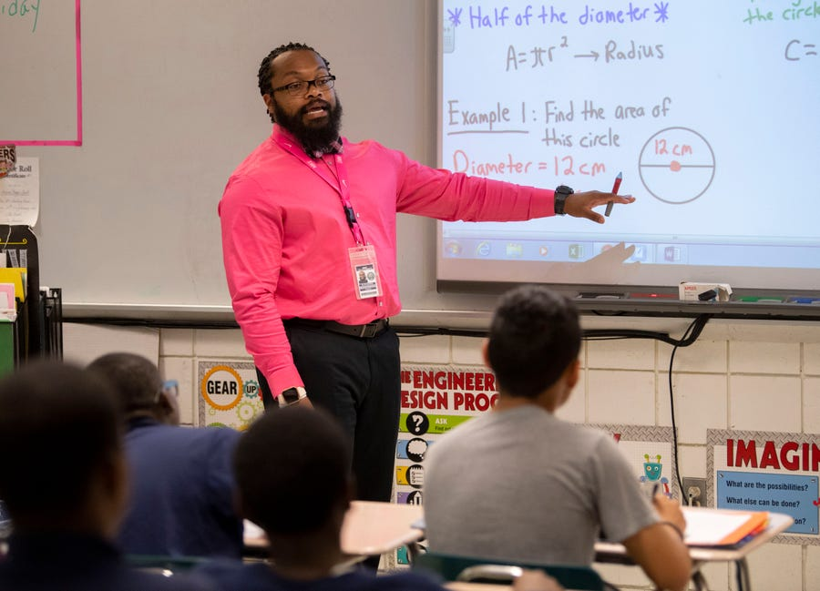 Ryan Brown, a middle-school teacher in Bridgeport, Connecticut, lives at his parents' home 45 minutes away. He has joined Educators for Excellence, a group that's backing a bill that would allow cities to create affordable housing programs for teachers. (Robert Deutsch, USA Today)