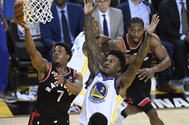 Toronto Raptors guard Kyle Lowry (7) makes a layup as Golden State Warriors forward Jordan Bell (2) defends during the first half of Game 3 of basketball's NBA Finals, Wednesday, June 5, 2019, in Oakland, Calif. (Frank Gunn/The Canadian Press via AP)