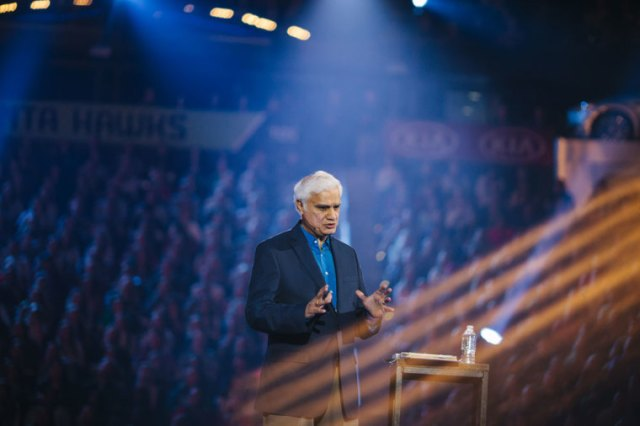 Christian apologist and author Ravi Zacharias speaks to tens of thousands of young adults in Atlanta's Philips Arena on Sunday, January 3, 2016. Students in Houston were able to watch Zacharias through livestream for the first time in Passion's 19 year history. | (Courtesy of Passion Conference/Phil Sanders)