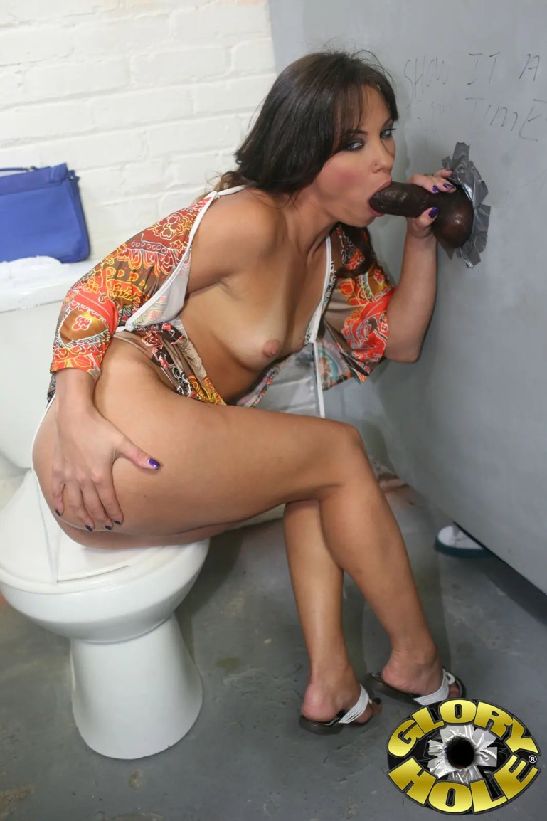 MILF-ey Alysa at a BBC Gloryhole - image  on https://blackcockcult.com
