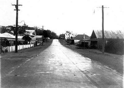 Shops in Old Bulli looking south with the Uniting Church and Denmark Hotel in the background - Henry Fry's shop was on the left