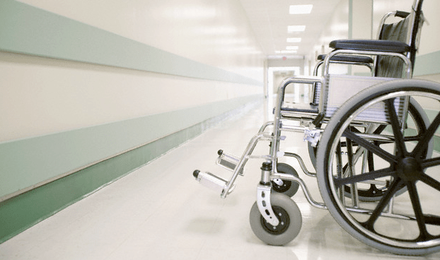A wheelchair sitting in a hospital hallway