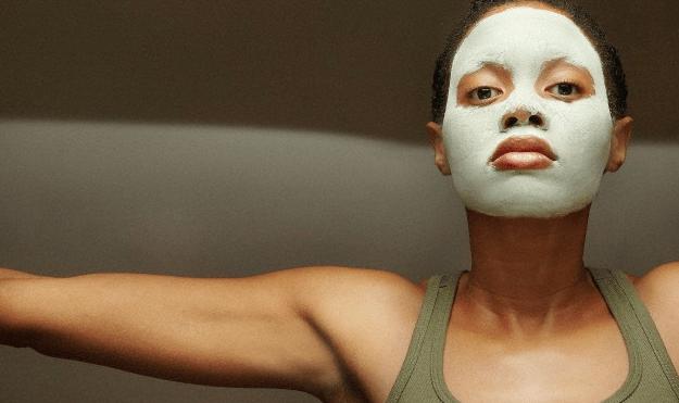 A woman wearing a mud face mask