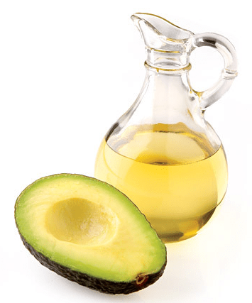 A sliced avocado and a jar of avocado oil