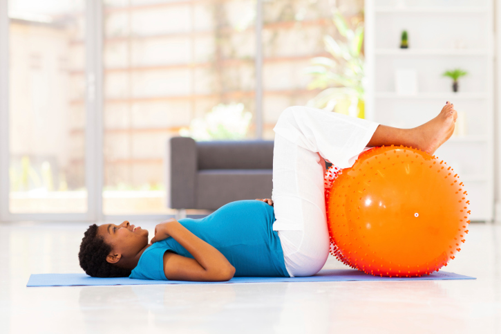 pregnant woman on mat