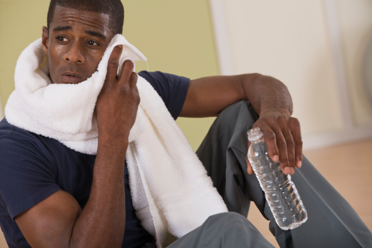 Man with bottled water and towel