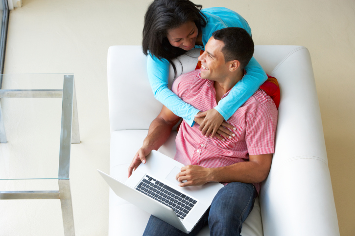 couple on couch computer