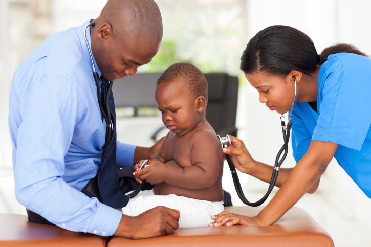 baby with doctors