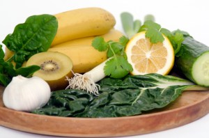 fruit and spinach in a bowl