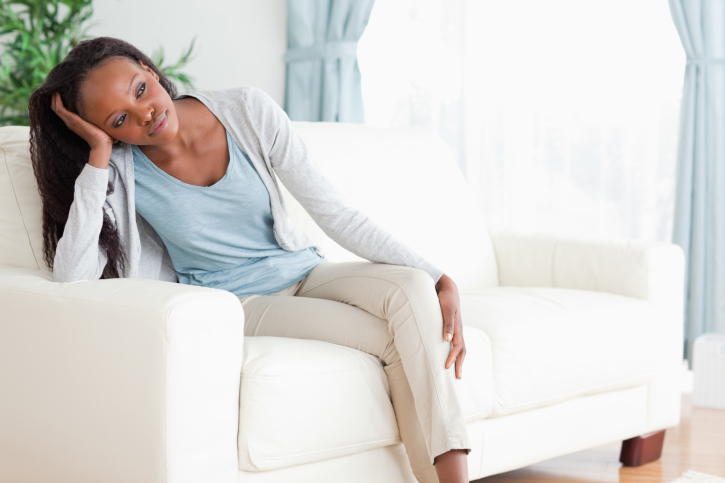 woman deep thought couch