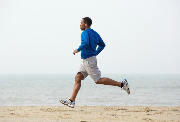 man running beach