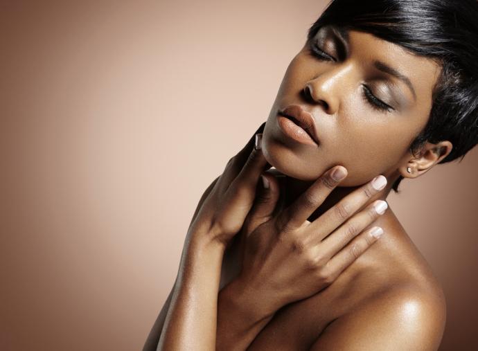 sensual black woman touching her face
