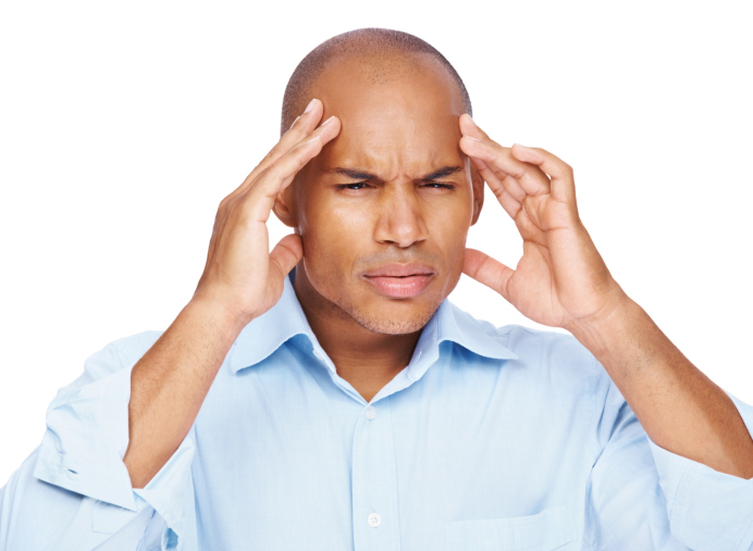 man stressed holding head