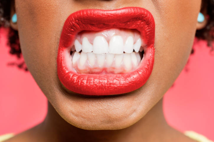 Detail shot of woman clenching teeth