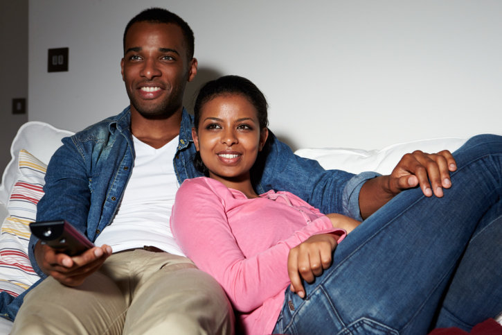 couple on couch watching TV
