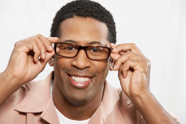 Man holding eye glasses