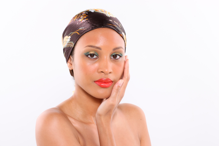 head shot of african american woman wearing head scarf