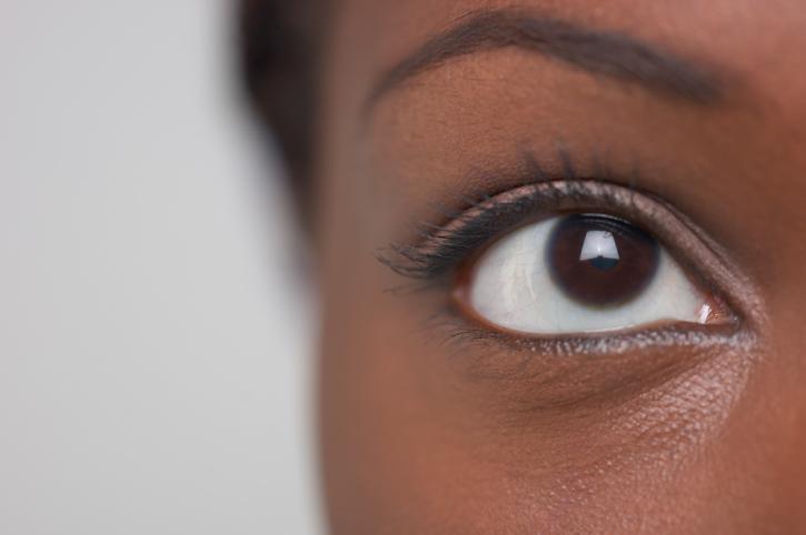 woman left brown eye