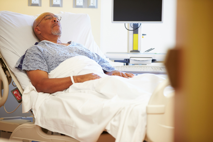 African American man in hospital bed