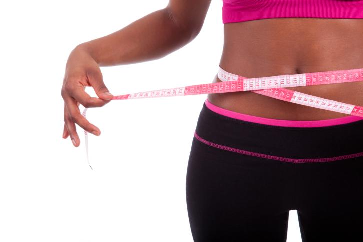 African American Black woman measuring waist