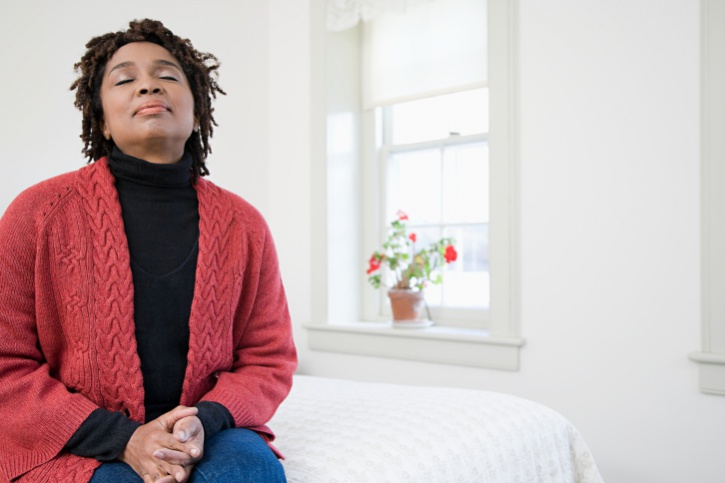 African American Black woman older meditating breathing peaceful