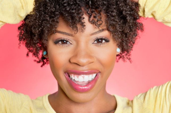 African American woman smiling with curly short hair