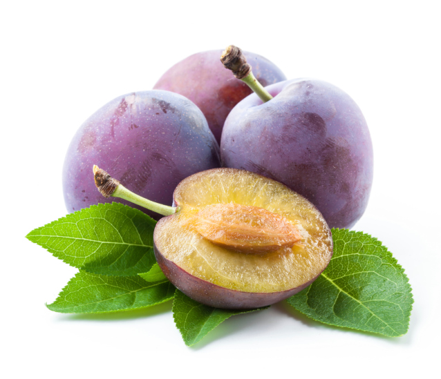 Plums and a half with leaves