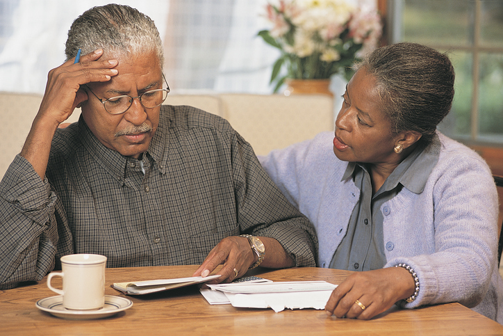 Senior African American couple going over bills