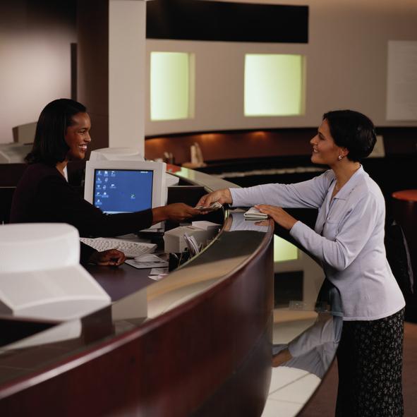 Teller Handing Woman Money at a Bank
