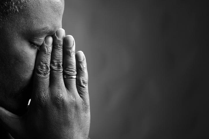 African American man upset sad grieving