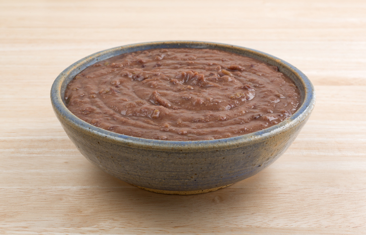 Black bean dip in a bowl on a wood table