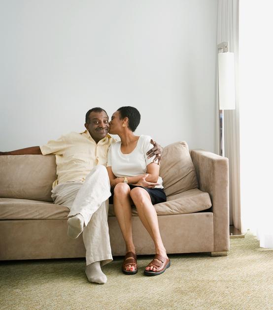 Senior African woman kissing husband on cheek