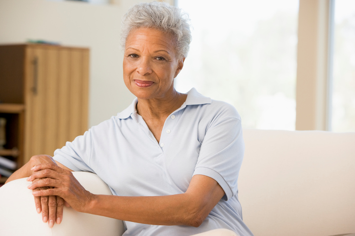 older African American woman sitting on couch