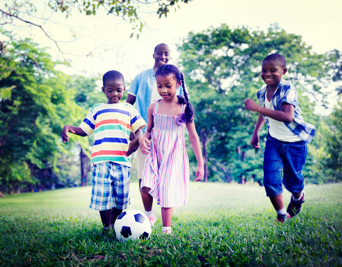 African American family playing outside