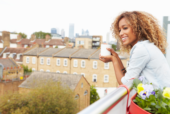 African American woman smiling on rooftop