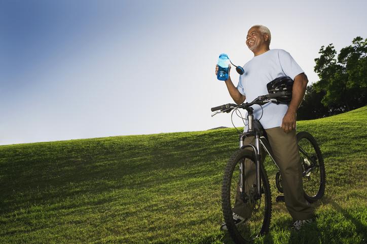 Senior African American man on bike
