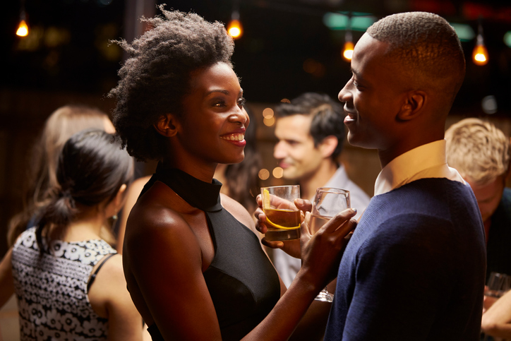 Couples Dancing And Drinking At Evening Party