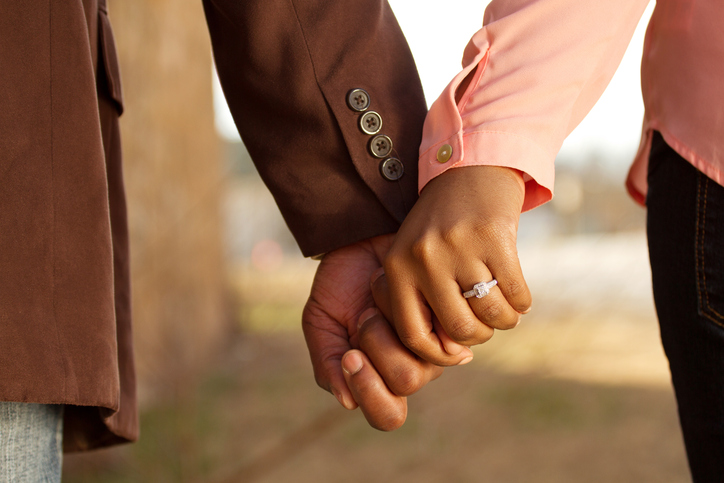 African American couple holding hands engaged