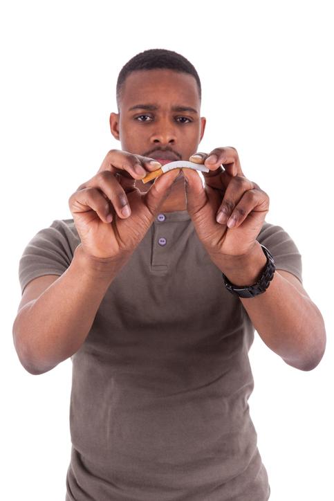 African American man breaking a cigarette