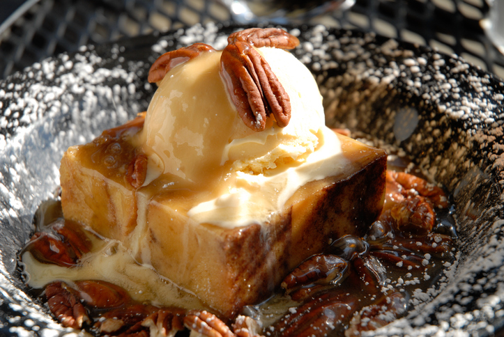 Bread Pudding with Ice Cream, Pecans and Powdered Sugar