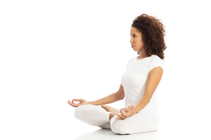 woman in yoga cross leg