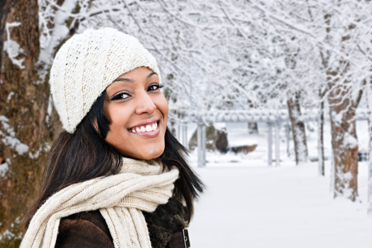 African American woman happy outside winter snow