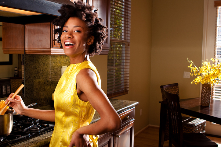 African American woman cooking