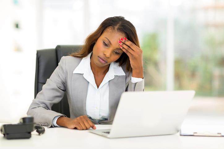 African American woman at work headache